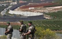 Lebanese army soldiers deploy on Lebanon'sside of the Lebanese-Israeli border in the southern village of Kfar Kila