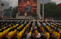 A screen shows Chinese President Xi Jinping speak during a ceremony to mark the 100th anniversary of the founding of the ruling Chinese Communist Party at Tiananmen Square in Beijing, July 1, 2021.