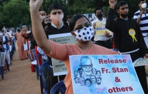 A Christian nun, center, holds a placard and shouts slogans with others demanding the release of tribal rights activist Stan Swamy and other activists during a demonstration in Bengaluru, India,Nov. 12, 200.