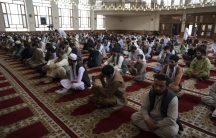 """Muslims offer Eid al-Adha prayers in Kabul, Afghanistan,July 20, 2021. Eid al-Adha, or """"Feast of the Sacrifice,"""" commemorates the Quranic tale of Prophet Ibrahim's willingness to sacrifice his son as an act of obedience to God."""