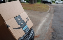 An empty Amazon box sits outside a north Jackson, Miss., residence, awaiting pickup for recycling