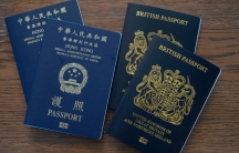 Blue British National Overseas passports (BNO) and Hong Kong Special Administrative Region of the People's Republic of China passports are displayed