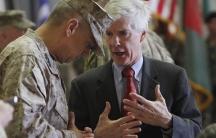 USGen. John R. Allen, left, commander of NATO forces in Afghanistan, listens to USambassador to Afghanistan, Ryan Crocker, before a change of command ceremony in Kabul, Afghanistan