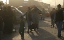 Hundreds gather at the Kabul airport