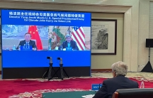 In this Sept. 2, 2021, file photo provided by the US Department of State, US Special Presidential Envoy for Climate John Kerry attends a meeting with Yang Jiechi, director of China's Office of the Central Commission for Foreign Affairs