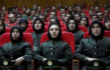 Newly trained female officers from the Afghan National Army sit in front seats as a new batch of officers attend their graduation ceremony at National Army's training center in Kabul on Sept. 23, 2010.