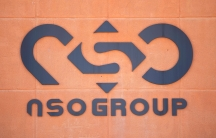 A logo adorns a wall on a branch of the Israeli NSO Group company, near the southern Israeli town of Sapir, Tuesday, Aug. 24, 2021.