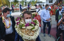 France's President Emmanuel Macron woreflowerleis and seashell necklaces as he arrived at the Manihi Atoll, 312 milesnortheast of Tahiti, French Polynesia, in the Pacific Ocean,July 26, 2021.