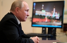 Russian President Vladimir Putin speaks to Ella Pamfilova, head of Russian Central Election Commission during their meeting via video conference at the Novo-Ogaryovo residence outside Moscow, Russia