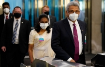 Gotabaya Rajapaksa, president of Sri Lanka, right, arrives at United Nations headquarters, during the 76th Session of the UN General Assembly in New York