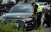 Police officers collect evidence near the car of Serhiy Shefir, first assistant to President Volodymyr Zelenskiy, that was shot at, near Kyiv, Ukraine