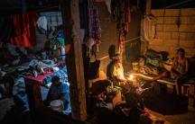 People displaced by gang violence occupy a school turned into a long-term shelter, in Port-au-Prince, Haiti, Thursday, Sept. 16, 2021.
