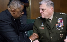 Secretary of Defense Lloyd Austin and Chairman of the Joint Chiefs Chairman Gen. Mark Milley are shown sitting and facing each other.