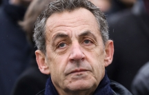 A close up photograph of French former president Nicolas Sarkozy who is wearing a scarf.