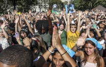 Climate change activists show hands in support of climate action during a climate strike rally, as part of a global youth-led day of global action.