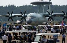 Visitors look at the Chinese military's KJ-500 airborne early warning and control aircraft during 13th China International Aviation and Aerospace Exhibition, also known as Airshow China 2021, in Zhuhai in southern China's Guangdong province