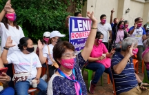 Supporters of Philippine Vice President Leni Robredo gesture as they wait for her to declare her bid to run for president in next year's elections in Quezon city, Metro Manila, Philippines on Thursday, Oct. 7, 2021.