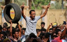 Thousands of pro-democracy protesters take to the streets to condemn a takeover by military officials in Khartoum, Sudan