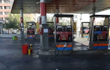 A gas station is empty because the gas pumps are out of service in Tehran, Iran, after a widespread outage of a system that allows consumers to buy fuel with a government-issued card