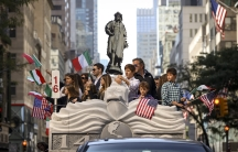 Italian Americans celebrating during a Christopher Columbus Day parade.