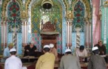 students praying at madrassa