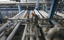 Employees close a valve of a pipe at a PetroChina refinery in Lanzhou, Gansu province January 7, 2011.