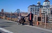 Ahlam and her infant daughter on the Brooklyn Bridge. Ahlam left Syria in late 2012 while pregnant to escape the violence there.