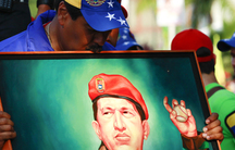 Venezuela's president, then-presidential candidate, Nicolás Maduro kisses a painting of late Venezuelan president Hugo Chávez during a campaign rally in the state of Vargas, April 9, 2013.