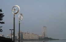 """Two experimental """"wind lenses"""" rise over a park in Fukuoka, Japan."""