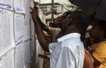 Volunteers check their ballot station positions in the Bayelsa state capital of Yenagoa on the eve of Nigeria's presidential election.
