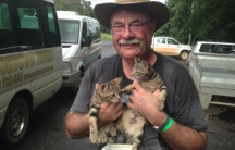 A photo from Warren Entsch's Facebook page shows the Australian conservative politician holding two cats.