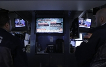 Traders watch developments following the explosions in Brussels on the floor of the New York Stock Exchange on March 22, 2016.