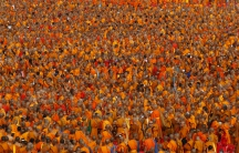 Over 100,000 Buddhist monks and novices gather to receive alms at Wat Phra Dhammakaya temple in Pathum Thani, outside Bangkok, on April 22, 2016.