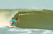 Ishita Malaviya catches a wave along the west coast of India.
