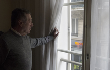 Paris resident and anti-noise activist Gerard Simonet peers through his double-paned windows to the street below. His ears are on constant alert for nocturnal revelers and honking horns.