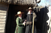 William and Alice Bradford in the doorway to their home. The couple is portrayed by real life couple, Chris and Norah Messier.