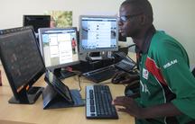 Philip Ogola runs Kenya Red Cross's social media command center from his desk in Nairobi.