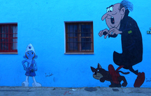 """Smurf characters adorn many of the walls in Juzcar. Tourists come from around the world to see the world's first ever """"Official Smurf Village."""""""