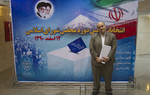 Iranian-Jewish minority Member of Parliament, Siamak Moreh Sedgh, poses for a photograph in front of a banner for the 2012 parliamentary elections.
