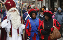 "Saint Nicholas is followed by his two assistants called ""Zwarte Piet"" (Black Pete) during a traditional holiday parade."