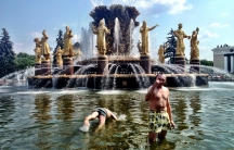 Two former Russian soldiers, Sevold (on the right) and Nikolai (diving), cooling off in a fountain in Moscow's VDNKh Park. Unlike many people in the park, these men expressed some concern about the impact of the new round of sanctions against Russia.  But