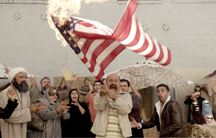 Maz Jobrani's character Jimmy Vestwood, an Iranian, panics when during a party to celebrate his winning a Green Card Lottery visa to the United State, his American flag is accidentally set on fire from a cigarette butt flicked into his yard by a neighbor.