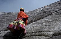 An Aymara indigenous woman practices climbing on the Huayna Potosi mountain, Bolivia April 2016.