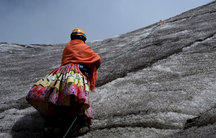 An Aymara indigenous woman practices climbing on the Huayna Potosi mountain, Bolivia April 2016.