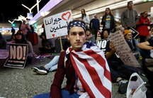 Demonstrators shut down the traffic loops at LAX International Airport and yell slogans during a protest against the travel ban imposed by President Donald Trump's executive order.