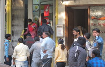 Two weeks after Prime Minister Narendra Modi announced the demonetization of 500 and 1000 rupee currency notes, residents of south Delhi continue to line up in front of ATMs in hopes of withdrawing cash.