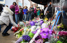 Fans lay flowers and memorials outside First Avenue, the nightclub where Prince got his start in Minneapolis, Minnesota.