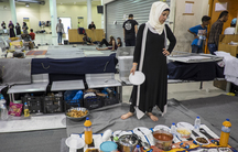 Renna Ramadan prepared an iftar meal for her family, Syrians from Idlib who hoped to reach Northern Europe but instead are living in the passenger waiting area at Piraeus Port Terminal 1 in Athens, Greece. Several hundred refugees and migrants remain at P