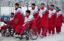 The delegation and the team of North Korea arrive at The Paralympic Village in Pyeongchang, South Korea, wearing red jumpsuits, March 8, 2018.