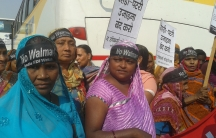 "Women wearing ""No Walmart"" head bands at a protest outside Walmart India offices in Gurgaon, India."